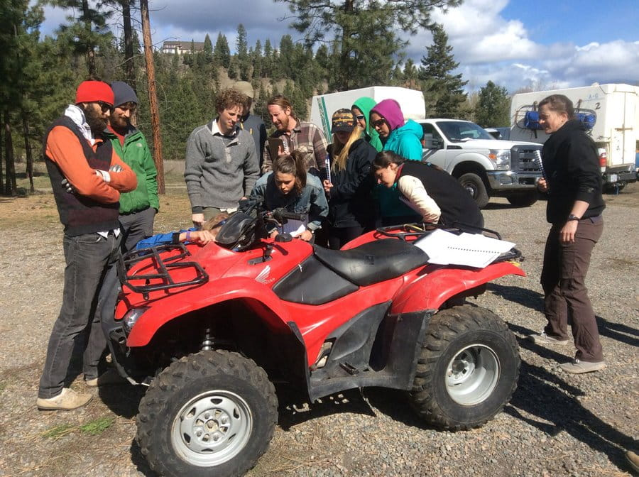 A group of trainees learn about ATVs